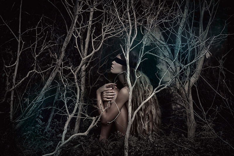 Young beautiful blindfolded woman in forest, photograph by Zolotareva Elina